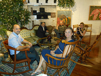 Family visiting in the sitting area with art seen on the walls in the background.