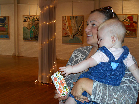 Faith Ecenroad Wise viewing the exhibit for the first time with daughter Neave. Faith pointed out that three years ago Lewis traveled to Lancaster PA for her wedding at The Cork Factory. Who knew that three years later his never before seen paintings would fill another of Lancaster's restored historical industrial buildings a few blocks away at Mulberry Art Studios.