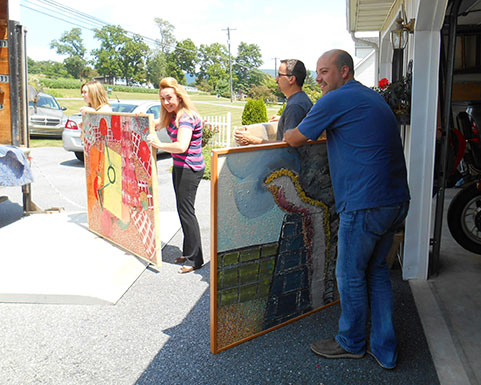 Jada, Joy, Jason and Peter ready to load paintings on the back of April's box truck.